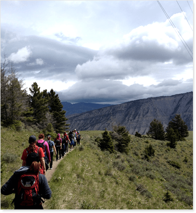 Girls hiking on a mountain from Eva Carlston Academy