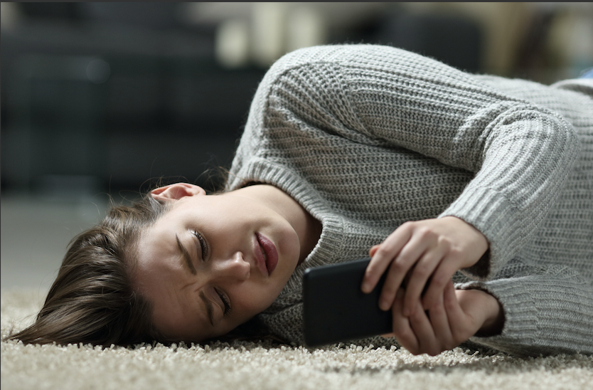 Girl-laying-on-floor-with-phone